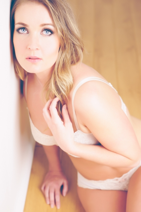 looking up at camera for boudoir photograph