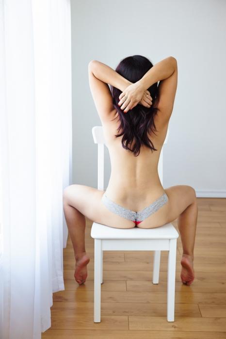 girl on chair for boudoir photograph