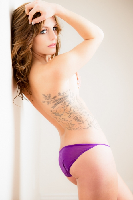 boudoir pose with back against wall
